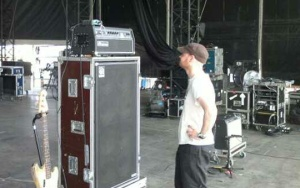 Colin squares up to a bass amp during soundcheck